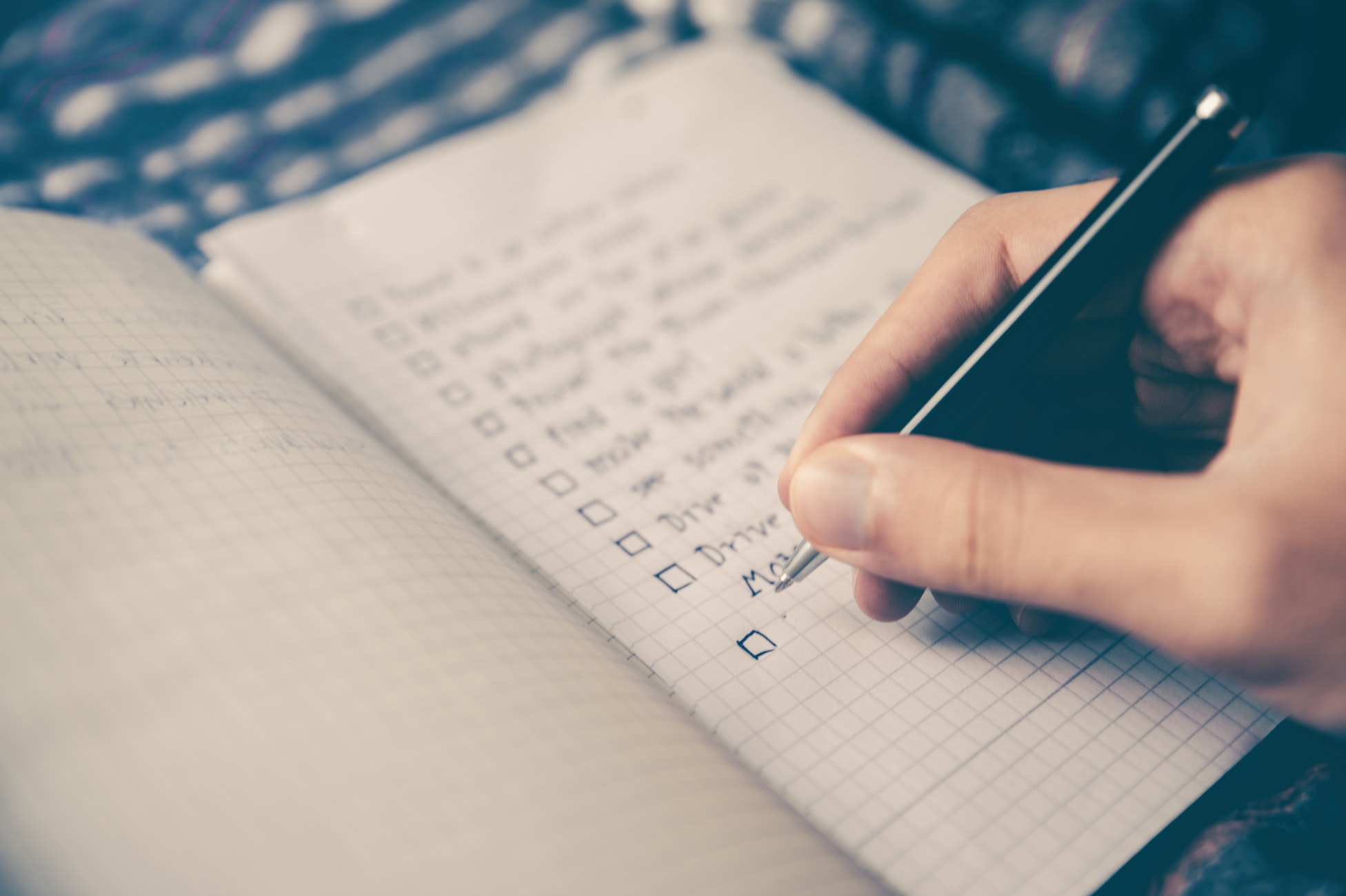 Person making a checklist in a journal